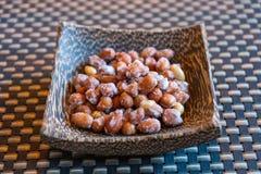 Açúcar que reveste amendoins roasted para o petisco fotos de stock