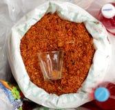 Açafrão em um saco com um vidro Fotografia de Stock Royalty Free