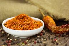 Açafrão em uns pires com pimenta e pimentão Fotos de Stock
