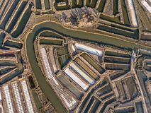 aéreo Campos Textured de lagos de sal pantanosos Salines Portugal Vila Real Santo Antonio Fotos de Stock