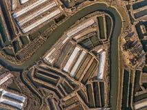 aéreo Campos texturizados de los lagos de sal cenagosos Salines Portugal Vila Real Santo Antonio Imagen de archivo libre de regalías