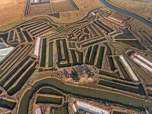 aéreo Campos texturizados de los lagos de sal cenagosos Salines Portugal Vila Real Santo Antonio Foto de archivo libre de regalías