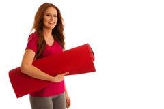 Aérobic - femme avec le tapis prêt à établir d'isolement au-dessus du blanc Photographie stock