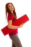 Aérobic - femme avec le tapis prêt à établir d'isolement au-dessus du blanc Image stock