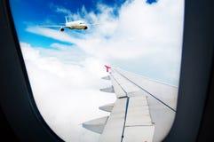Aéronefs hors de l'hublot Photographie stock