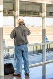 Aéroport de DFW - passagers dans la station de Skylink Image libre de droits