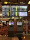 Aéroport du ` s Changi de Singapour de conseil de l'information de vol Photographie stock