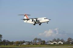 Aéroport Schiphol d'Amsterdam - Avro RJ85 de CityJet débarque Image libre de droits