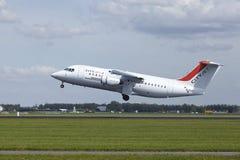 Aéroport Schiphol d'Amsterdam - Avro RJ85 de CityJet décolle Photo libre de droits