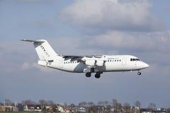 Aéroport Schiphol d'Amsterdam - CityJet Avro RJ85 débarque Photographie stock