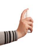 Aérosol du pressurage à la main de la femme Photographie stock libre de droits