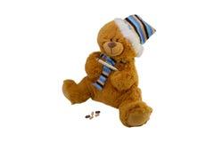 Aísle el oso de peluche del juguete de los niños macros en una bufanda con el tabl Fotografía de archivo libre de regalías
