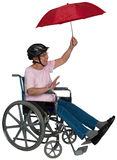 Aîné actif heureux de fauteuil roulant d'isolement Photo libre de droits