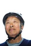 aîné asiatique d'homme de casque de vélo Photos stock