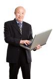 aîné asiatique d'ordinateur portatif d'homme d'affaires Image libre de droits