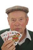 Aîné avec des cartes de jeu Image stock