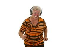 Aîné avec l'écouteur Image libre de droits