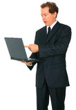 aîné caucasien de point d'ordinateur portatif d'homme d'affaires Photos libres de droits