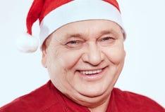 Aîné dans le chapeau de Santa Claus Photo libre de droits