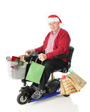 Aîné et scooter chargés avec des cadeaux Image libre de droits