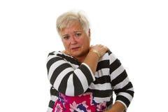 Aîné féminin avec douleur cervicale Image stock