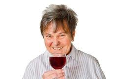 Aîné féminin avec du vin en verre Photos libres de droits
