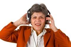 Aîné féminin avec l'écouteur Image libre de droits