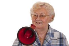 Aîné féminin avec le mégaphone Photo libre de droits