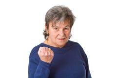 Aîné féminin avec le poing serré Image stock