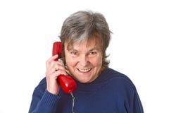 Aîné féminin avec le récepteur téléphonique Images libres de droits
