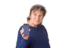 Aîné féminin avec son smartphone Images libres de droits