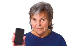 Aîné féminin avec son smartphone Photographie stock libre de droits