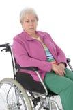 Aîné féminin dans le fauteuil roulant Photo libre de droits