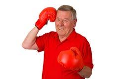 Aîné mâle avec des gants de boxe Photos stock