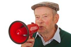 Aîné mâle avec le mégaphone Photographie stock libre de droits