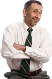 aîné riant exécutif de pose de verticale Photo stock