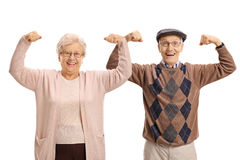 Aînés joyeux fléchissant leurs biceps Image stock