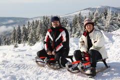 Aînés sledging Photos libres de droits