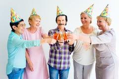 Aînés sur une fête d'anniversaire Image libre de droits