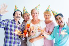 Aînés sur une fête d'anniversaire Photographie stock libre de droits