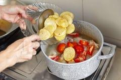 Añada la patata Fotografía de archivo libre de regalías