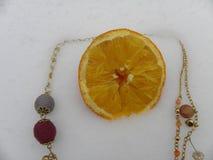 Año anaranjado de la nieve con una gema Fotos de archivo libres de regalías