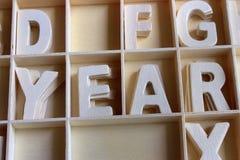 Año de la palabra hecho con alfabeto de madera de las letras Fotos de archivo libres de regalías