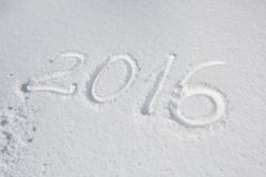 Año 2016 escrito sobre nieve Fotografía de archivo libre de regalías