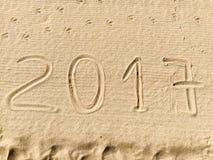 Año 2017 exhausto en la arena Imágenes de archivo libres de regalías