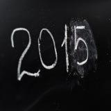 Año número 2015 escrito en el tablero Fotografía de archivo