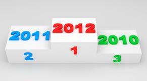 Año Nuevo 2012 en un podium Imágenes de archivo libres de regalías