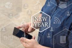 Año Nuevo, botón en la pantalla táctil con un fondo de la falta de definición de t Fotos de archivo