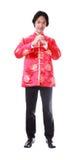 Año Nuevo chino feliz Hombre asiático joven con el gesto del congratul Imágenes de archivo libres de regalías