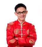 Año Nuevo chino feliz Hombre asiático joven con el gesto del congratul Foto de archivo